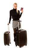 Woman standing with suitcases and travell documents excited to g Stock Image