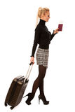 Woman standing with suitcases and travell documents excited to g Royalty Free Stock Photo