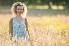 Woman standing in a summer meadow Royalty Free Stock Photography