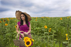 Woman standing in sunflower field Stock Photography
