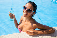 Woman standing in swim pool Royalty Free Stock Photos