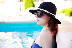 Woman standing in the swimming pool Royalty Free Stock Image