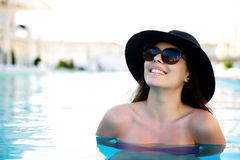 Woman standing in swimming pool Royalty Free Stock Image