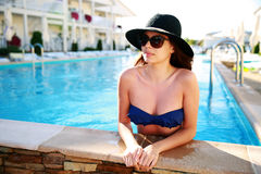 Woman standing in swimming pool Royalty Free Stock Images