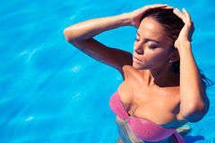 Woman standing in swimming pool Royalty Free Stock Photos