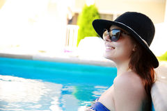 Woman standing in the swimming pool Royalty Free Stock Photo