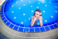 Woman standing in a swimming pool Royalty Free Stock Photography