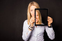 Woman standing with tablet in her hands Royalty Free Stock Photography
