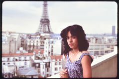 Woman standing on terrace view on Eiffel Tower Stock Image