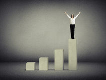 Woman standing on top of diagram Royalty Free Stock Images