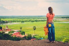 Woman standing on top of a hill enjoying Floating village view, Phnom Krom, Siem Reap,  Cambodia Stock Photos
