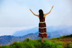 Woman is standing on top of the mountain Royalty Free Stock Photo