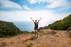 Woman standing On Top Of Mountain Royalty Free Stock Photo