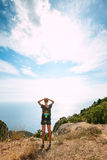 Woman standing On Top Of Mountain Royalty Free Stock Photography