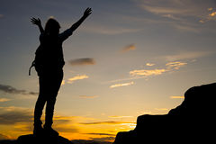 Woman standing on top of mountain Stock Photo