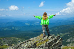 Woman  standing at top rock Stock Image