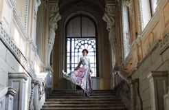 Woman standing on the top of a stairway Royalty Free Stock Photography