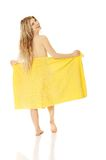 Woman standing with a towel Royalty Free Stock Images
