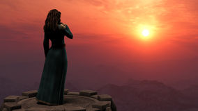 Woman Standing on Tower in Mountains at Sunset Royalty Free Stock Photo