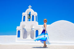 Woman standing by the traditional greek church Royalty Free Stock Image