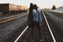 Woman Standing on Train Rail Royalty Free Stock Photography