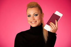 Woman standing with travell documents excited to go on vacations Stock Photo