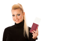 Woman standing with travell documents excited to go on vacations Royalty Free Stock Images