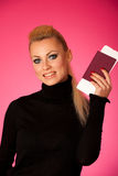 Woman standing with travell documents excited to go on vacations Royalty Free Stock Photos