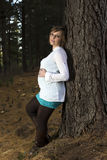 Pregnant Woman standing tree  Stock Photo