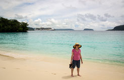 Woman Standing on Tropical Beach Stock Photography
