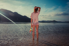Woman standing on tropical beach with snorkel Royalty Free Stock Photography