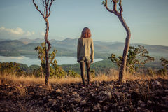Woman standing between two trees Royalty Free Stock Image