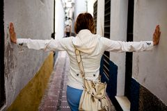 Woman standing on typical spanish street in town Royalty Free Stock Photos