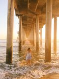 Woman Standing Under the Bridge on the Sea Royalty Free Stock Images