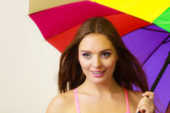 Woman standing under colorful rainbow umbrella Royalty Free Stock Images
