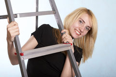 Woman standing under a ladder. Woman in a short skirt standing under ladder Royalty Free Stock Photo