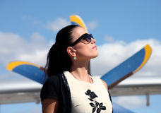 Woman standing under the propeller of an aircraft Royalty Free Stock Photos