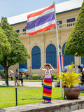 Woman Standing under Thai Flag Royalty Free Stock Photos