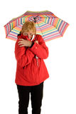 Woman standing under umbrella Stock Image