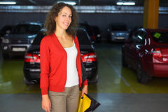 Woman standing in underground car park Royalty Free Stock Image