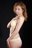 Woman standing in underwear Royalty Free Stock Image