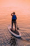 Woman standing up on Paddle boat on Galve Lake Trakai stock photos