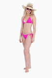 Woman standing upright wearing pink swimsuit Stock Image