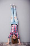 Woman standing upside down Stock Photography