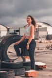 Woman Standing on Vehicle Tire