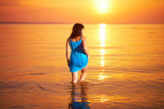 Woman standing in water Royalty Free Stock Photos
