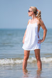 Woman standing in water on the beach Royalty Free Stock Images
