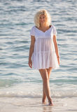 Woman is standing in water of Indian ocean Royalty Free Stock Photo