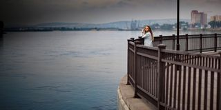 Woman standing on waterfront Stock Image