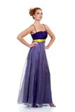 Woman standing wearing a purple lace dress Royalty Free Stock Photos
